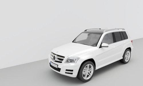 Eine weiße GLK Klasse parkt in einem grauen Raum