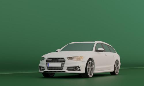 Ein weißer Audi S6 in einem grünem Raum